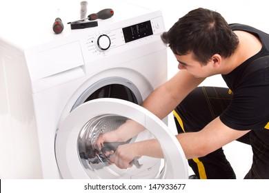 studio photo of washing machine repairman