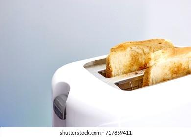 A studio photo of a white toaster