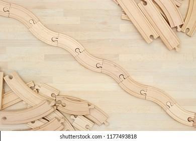 A studio photo of a wooden train track