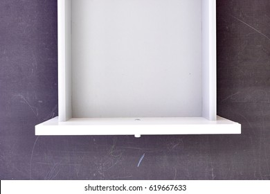 A studio photo of a workplace office desk drawer