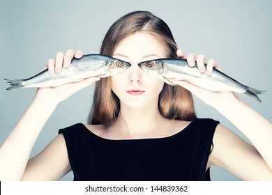 Studio photo of a young woman with the fishes