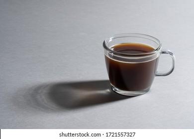 a studio photograph using coffee and coffee cups