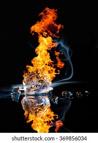 studio photography of a burning ice crystal and smoke in black reflective back