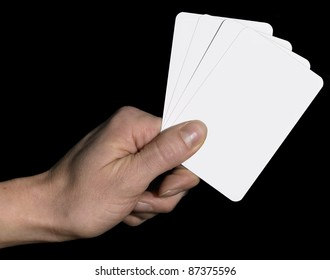 studio photography of a hand and white playing cards in dark back