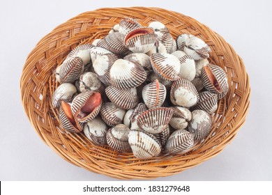 Studio photography of raw cockles in a bamboo basket, South Korea