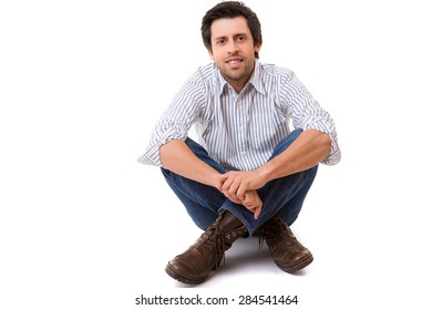 Studio picture of a casual man posing isolated