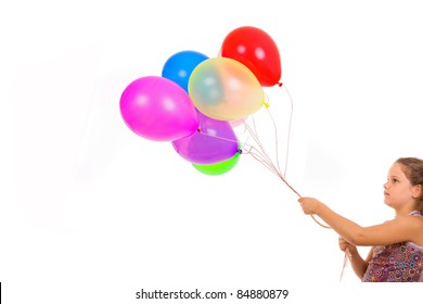 Studio picture from a little girl with balloons, isolated on white