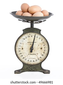 studio picture of a metal scales holding eggs