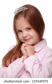 Studio portrait of adorable young girl is posing on camera on Holiday and Fashion theme