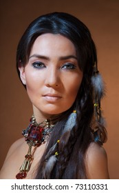 Studio portrait of American Indian woman with professional makeup