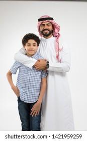 Studio portrait of arab father and son