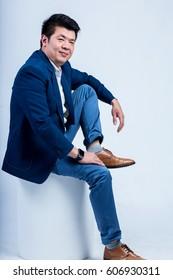 studio portrait of an asian businessman.