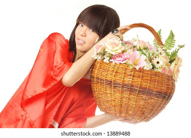 Studio portrait of the Asian flower girl with rose basket