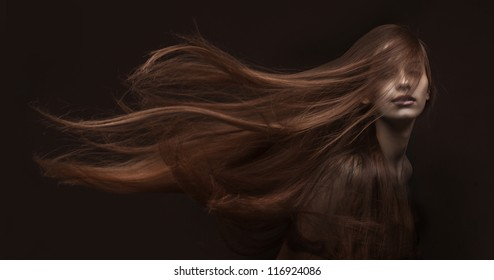 studio portrait of attractive young woman with long hair