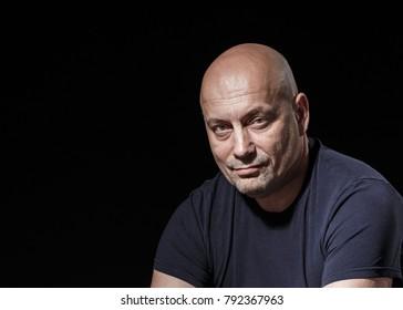 Studio portrait of bald man