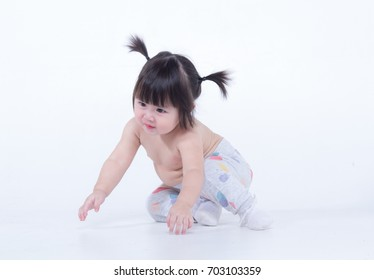 Studio portrait a beautiful baby girl 9 months, Asian kid, Isolated on white background