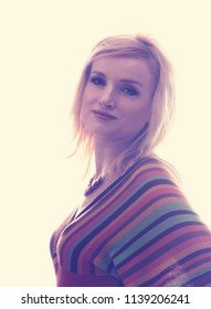 Studio portrait of a beautiful blonde girl. She is dressed in a knitted blouse in a strip, on her neck she has a beautiful necklace. Clothing in the style of the 1970s. A clean background. Isolated
