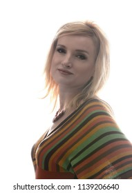 Studio portrait of a beautiful blonde girl. She is dressed in a knitted blouse in a strip, on her neck she has a beautiful necklace. Clothing in the style of the 1970s. A clean white background.