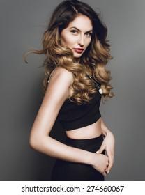 Studio portrait of a beautiful fashion girl in profile
