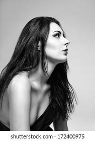 Studio portrait of a beautiful girl. Profile view. Black and white photo