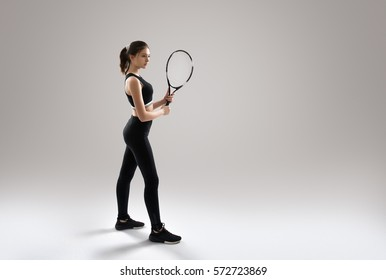 Studio portrait of beautiful girl tennis player with a racket.