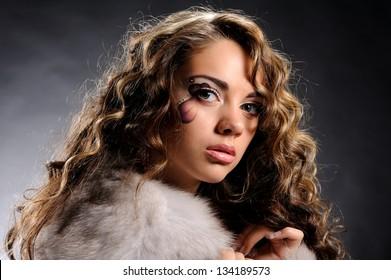 Studio portrait of beautiful sexy girl  in fashion style