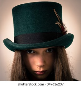 Studio portrait of a beautiful victorian girl with very long hair wearing a  green top hat e706a1acce0b