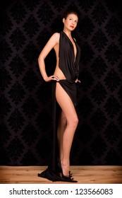 Studio portrait of a beautiful woman in an evening dress