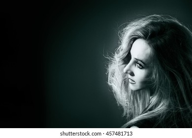 Studio portrait of the beautiful woman on black background