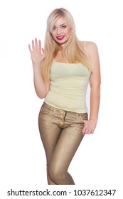 Studio portrait of a beautiful young blond woman with long hair, dressed in a summer yellow jersey and golden jeans. Concept: summer mood. Isolate. Copy space