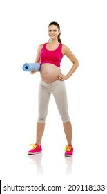 Studio portrait of a beautiful young pregnant woman holding mat ready for exercising, isolated on white background