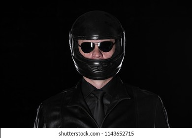 studio portrait of a biker