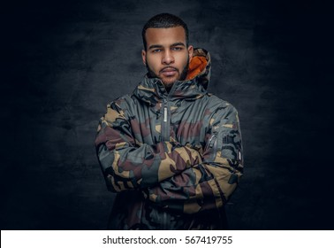 Studio portrait of Black man dressed in military jacket.