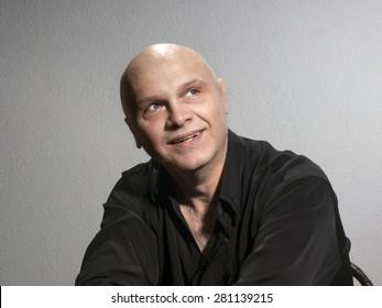Studio portrait of caucasian bald men. Emotions. Dreamy