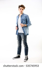 Studio portrait of caucasian young man standing up on white background. fashion guy latin lover