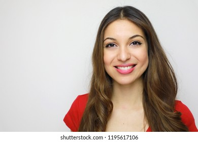 Studio portrait of cheerful beautiful girl with red t-shirt. Attractive young woman looking to the camera on white background. Copy space.