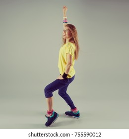 Studio portrait of cheerful fitness woman training aerobics.