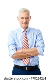 Studio portrait of a confident senior man standing with arms crossed at isolated white background.