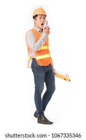 Studio portrait of construction worker in orange waistcoat and hardhat using walkie-talkie