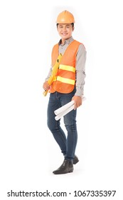 Studio portrait of construction worker in orange waistcoat and hardhat holding levelling tool and building plan
