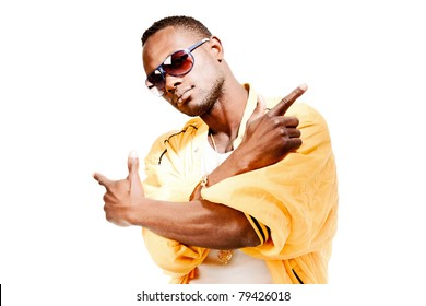 Studio portrait of cool gangster rapper with sunglasses and yellow jacket. Isolated on white background.