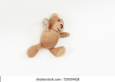 Studio portrait of a cute beige teddy bear for kids with happy smiling facial expression. Image isolated on white background., is running, toy on a white background