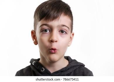Studio portrait cute boy whistling