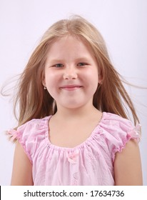 Studio portrait of cute child with blowing hair