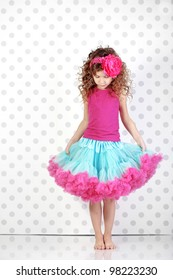 Studio portrait of cute little princess wearing beautiful tutu skirt