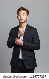 Studio portrait of an East Asian business man in a suit