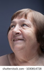 Studio portrait of elderly woman. Smile.