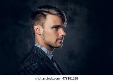 Studio portrait of elegant modern male in a suit.