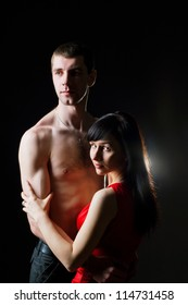 Studio portrait of embracing man and woman