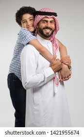 Studio Portrait of Father and Son